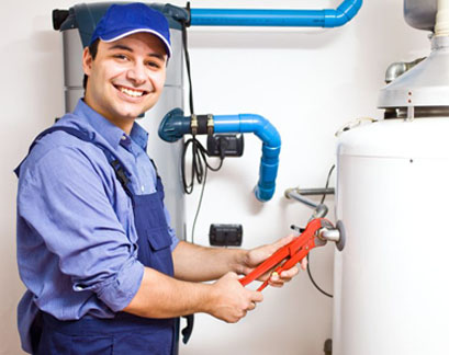 Repair man fixing furnace with wrench